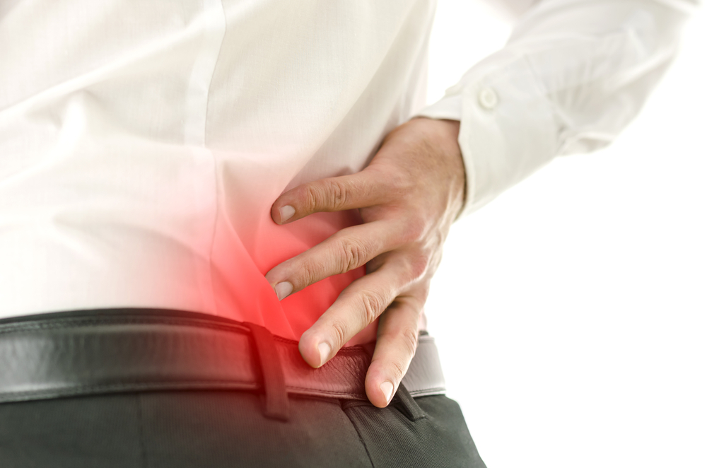 Man suffers from lower back pain needs treatment for sciatica in Guelph